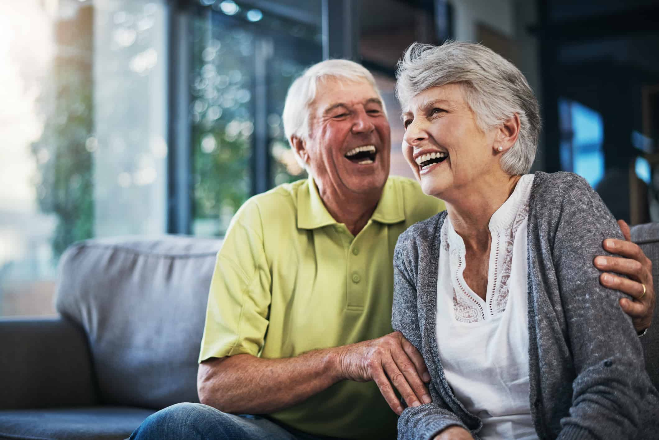 Shot of a happy senior couple relaxing together on the sofa at home